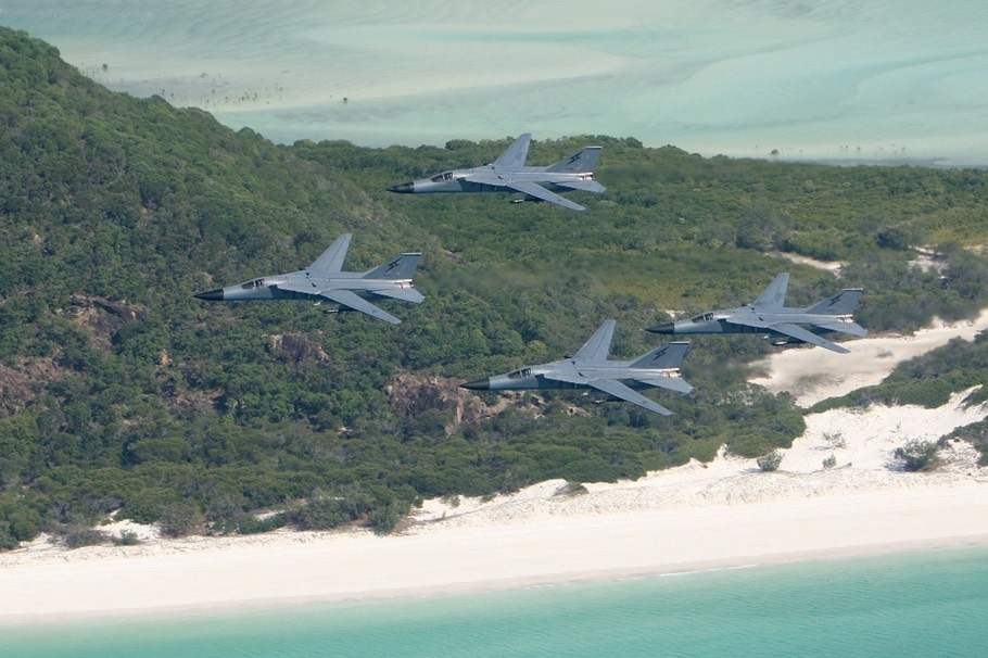 F-111 4 Aircraft Formation Over Beach